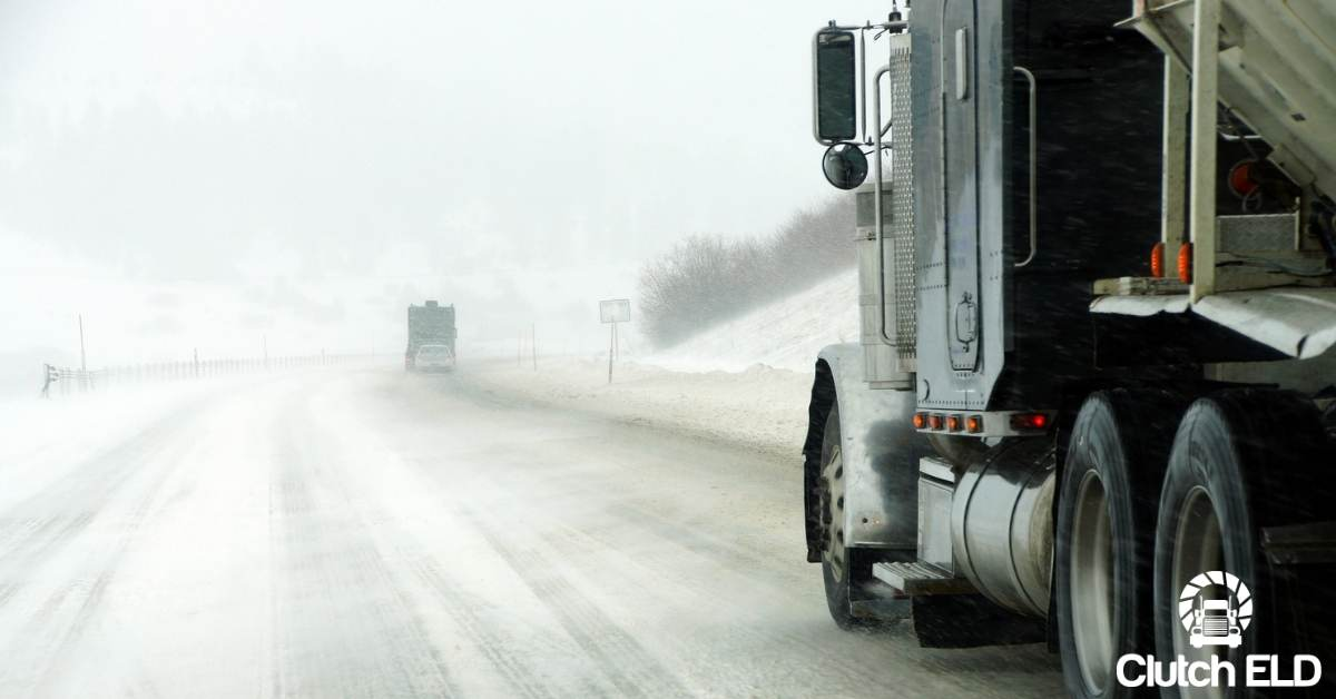 truck driver driving on snowy road