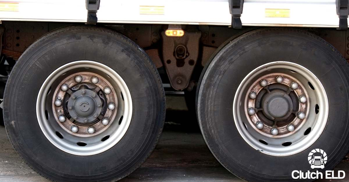 wheels of a tractor trailer as it's pulled over ready to be inspected during brake safety week 2020