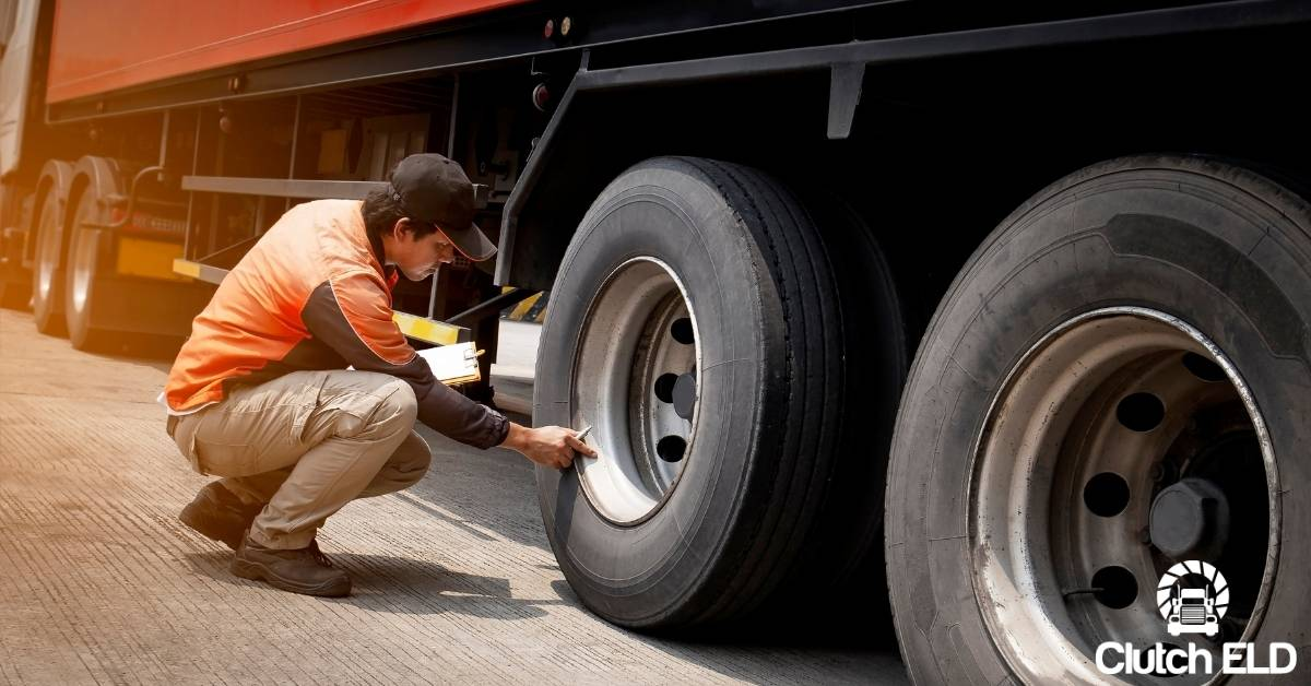 a truck driver inspecting his truck in order to make safety a priority in 2021